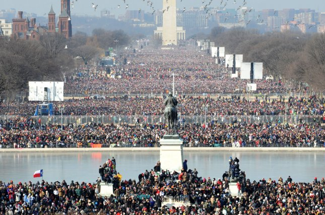 Birds fly in front of the Washington Monument as more than a million people fill the National Mall while Barack Obama takes the oath of office to become the 44th President of the United States on the west steps of the Capitol on January 20, 2009. UPI/Pat Benic