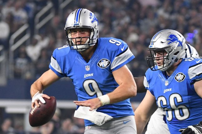 Detroit Lions Matt Stafford scrambles against the Dallas Cowboys during the first half at AT&T Stadium in Arlington, Texas on December 26, 2016. Ian Halperin/UPI