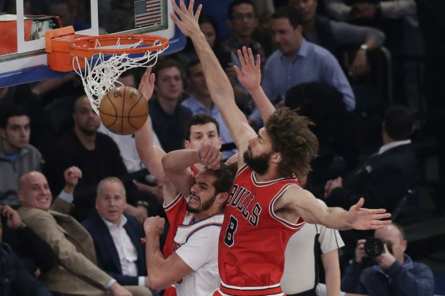 Chicago Bulls' Robin Lopez defends New York Knicks Joacim Noah under the basket in the first half at Madison Square Garden in New York City on January 12, 2017. Photo by John Angelillo/UPI