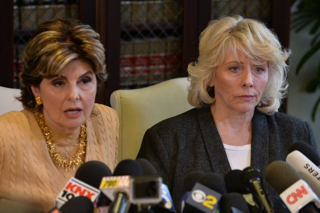 Former actress Heather Kerr (R) listens to attorney Gloria Allred after accusing media mogul Harvey Weinstein of sexual misconduct during a news conference in Los Angeles on Friday. Photo by Jim Ruymen/UPI