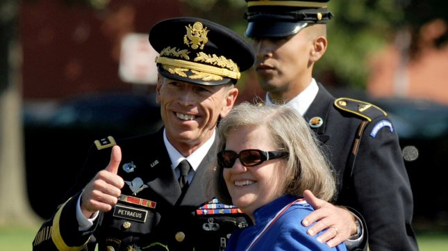 Gen. David Petraeus stands with his wife Holly during an armed forces farewell tribute and retirement ceremony in his honor at Ft. Myer in Virginia on August 31, 2011. UPI/Roger L. Wollenberg