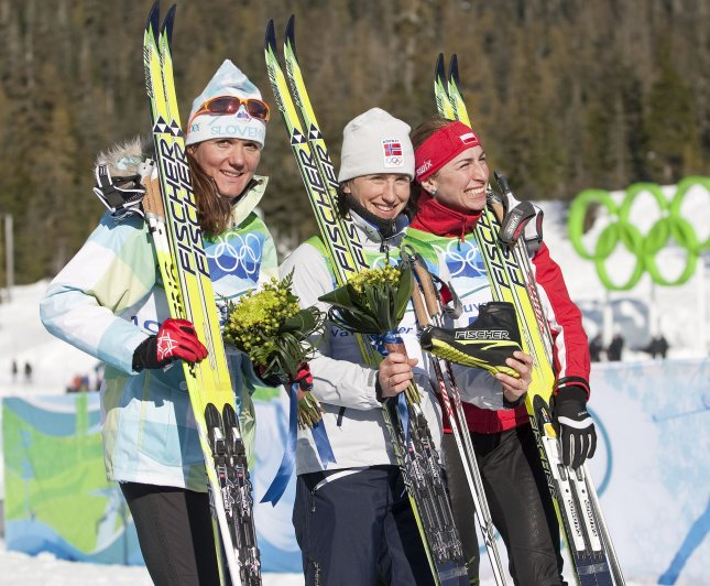 (L to R) Slovenia's Petra Madjic, Norway's Marit Bjoergen and Poland's Justyna Kowalczyk celebrate winning bronze, gold and silver, respectively, in the Cross Country Ladies' Individual Sprint Classic Finals at the Whistler Olympic Park during the Vancouver 2010 Winter Olympics in Whistler, British Columbia, Feb. 17, 2010. UPI /Heinz Ruckemann