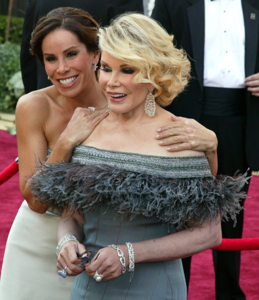 Joan Rivers (R) and her daughter Melissa Rivers arrive for the 78th Annual Academy Awards at the Kodak Theatre in Hollywood, Calif. (UPI Photo/Terry Schmitt)