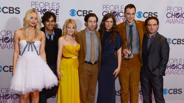 Cast of The Big Bang Theory (L-R) Kaley Cuoco, Kunal Nayyar, Melissa Rauch, Simon Helberg, Mayim Bialik, Jim Parsons and Johnny Galecki appear backstage after winning the Favorite TV Comedy award, during the 39th annual People's Choice Awards at Nokia Theatre L.A. Live in Los Angeles on January 9, 2013. UPI/Jim Ruymen