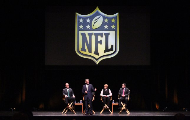 Represenatives from the National Football League (L to R) Chris Hardart, Eric Grubman, Cynthia Hogan and.Jay Bauman listen and discuss the St. Louis Rams possible move to Los Angeles during a town hall meeting at the Peabody Opera House in St. Louis on October 27, 2015. The Rams owner Stan Kronke has hinted that he wants to move the team to Los Angeles. Town hall meetings are also scheduled for Oakland and San Diego. Photo by Bill Greenblatt/UPI