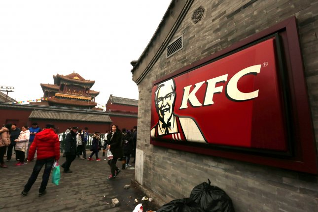 Chinese visit a KFC franchise located next to a nationally protected temple in Beijing on February 28, 2016. China has become one of the largest markets for KFC franchises in the world. Photo by Stephen Shaver/UPI