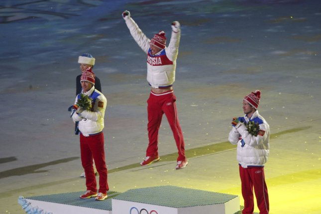 Russian cross-country skier Alexander Legkov (center) leaps into the air as he is announced as the gold medal winner for the men's 50km race at the 2014 Winter Olympics on Feb. 23, 2014 in Sochi, Russia. Legkov was among numerous Russian athletes later identified and accused by a Moscow doctor and anti-doping officials as having taken part in the nation's alleged state-sanctioned doping program. Russia won 33 medals, 13 of them gold, during the 2014 Winter Olympics -- more than any other nation. File Photo by Maya Vidon-White/UPI