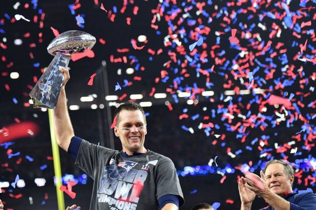 New England Patriots quarterback Tom Brady lifts the Vince Lombardi Trophy as Patriots head coach Bill Belichick looks on after defeating the Atlanta Falcons in Super Bowl LI at NRG Stadium in Houston on February 5, 2017. Brady sent a videotaped message to be played at the funeral of a Navy SEAL. File photo by Kevin Dietsch/UPI