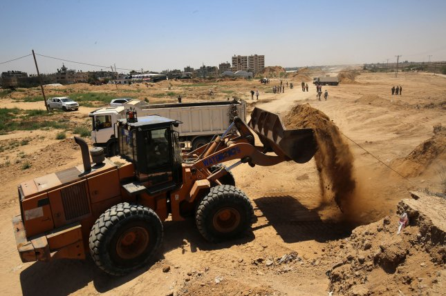 Palestinian bulldozers clear an area as Hamas begins creating a large buffer zone on the border with Egypt in the southern Gaza strip town of Rafah, on Wednesday. Photo by Ibrehim Khatib/UPI