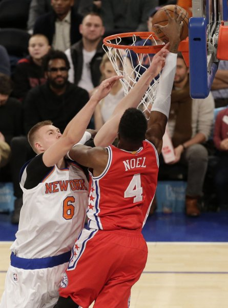 Nerlens Noel goes up for a shot against Kristaps Porzingis of the New York Knicks. Photo by John Angelillo/UPI