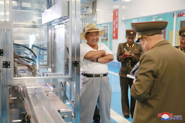 Kim Jong Un visits the Kumsanpo Fish Pickling Factory in August. North Korea claims socialist planning is being enforced but the reality is different, a South Korean activist said Friday. File Photo by KCNA/UPI