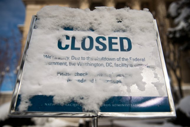 A snow-covered sign is seen at the National Archives during the partial federal government shutdown. Photo by Kevin Dietsch/UPI