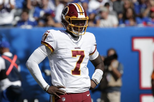 Washington Redskins rookie quarterback Dwayne Haskins struggled in his NFL debut Sunday, throwing three interceptions during a loss to the New York Giants. Photo by John Angelillo/UPI