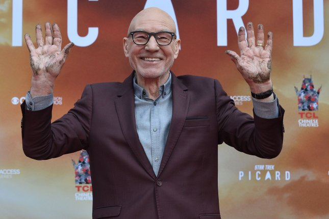 Patrick Stewart participates in a hand and footprint ceremony immortalizing him in the forecourt of the TCL Chinese Theatre on Monday. Photo by Jim Ruymen/UPI