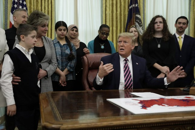 U.S. President Donald Trump hosted a group of students from Christian, Jewish and Muslim faiths in the Oval Office on National Religious Freedom Day and announced Constitutional Prayer in Public Schools in the Oval Office. The guidance seeks to clarify what type of religious expressions are, and are not, allowed by law in public schools. Photo by Yuri Gripas/UPI