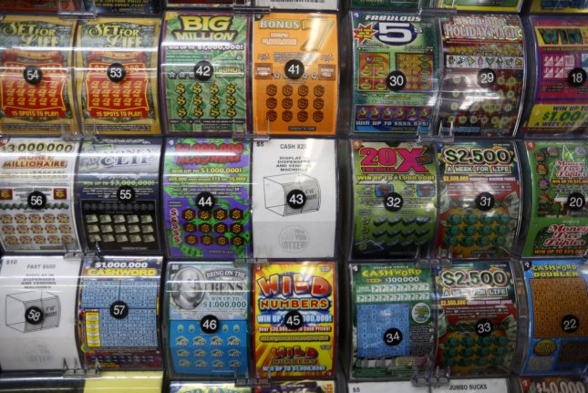 A Michigan man said stopping to put air in a leaky car tire led to his winning $1 million from a scratch-off lottery ticket. File Photo by John Angelillo/UPI