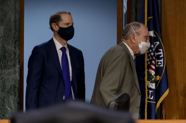Sen. Member Ron Wyden, D-Ore., left, and Sen. Chuck Grassley, R-Iowa, right, shown here Jan. 19, have cosponsored a bill that would require the Pentagon to pass an independent audit every year. File photo by Andrew Harnik/UPI