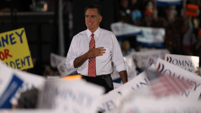 Republican presidential nominee Mitt Romney is applauded at a campaign event at the Augusta Expoland in Fishersville, Va., Thursday. UPI/Molly Riley