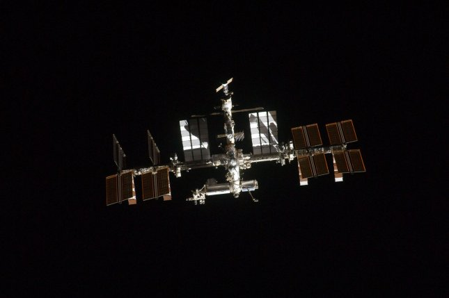 This NASA image taken on July 10, 2011 shows the International Space Station photographed by a crewmember onboard the space shuttle Atlantis as the two spacecraft performed rendezvous and docking operations on the STS-135 mission's third day in Earth orbit. UPI/NASA