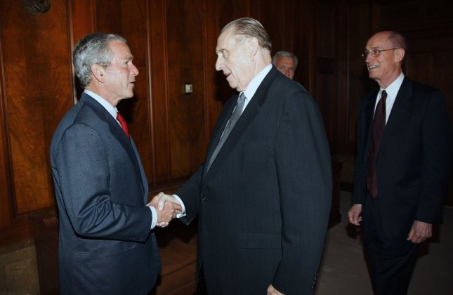 U.S. President George W. Bush (L) greets Thomas Monson, President of the Church of Jesus Christ of Latter-day Saints at the church's headquarters in Salt Lake City on May 29, 2008. At right is Henry Eyring, First Counsel in the Counsel of Twelve. (UPI Photo/Eric Draper/White House)