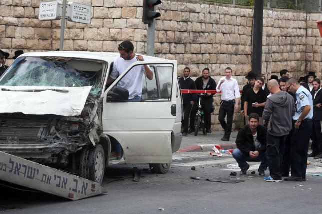An Israeli police inspects a van driven by a Palestinian who rammed his van into people at a crowded light rail platform in a terror attack in east Jerusalem, November 5, 2014. UPI