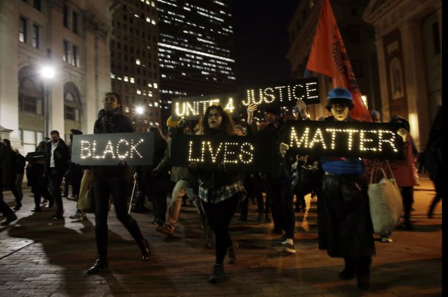 Relatives of the deceased Eric Garner lead a group of protesters as they march across the Brooklyn Bridge for the second night in a row following a decision by a grand jury not to indict an NYPD officer involved in the apparent chokehold death of Eric Garner in New York City on December 4, 2014. Garner, a 43 year old father of six, died in July after police officers attempted to arrest him for allegedly selling loose, untaxed cigarettes in the Tompkinsville section of Staten Island. UPI/John Angelillo