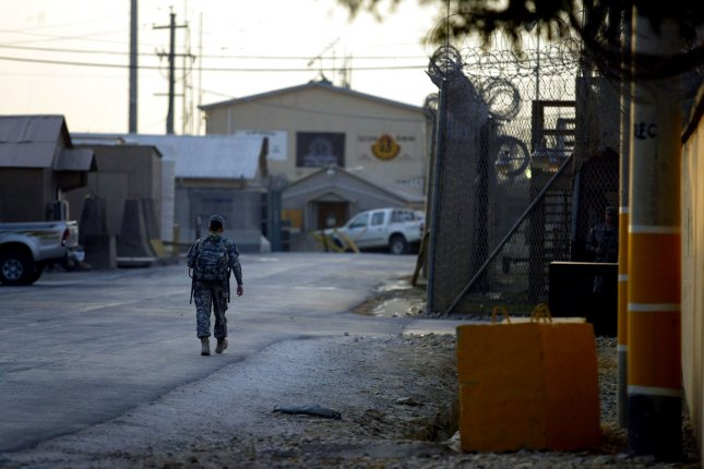 A U.S. service member walks along a road at the main U.S. base in Bagram, north of Kabul, Afghanistan on September 12, 2009. Latif Mehsud, a senior figure in the Pakistani Taliban, was held here since he was captured in Oct. 2013. He was reportedly released into custody of the Pakistani government earlier this week. File photo by Mohammad Kheirkhah/UPI
