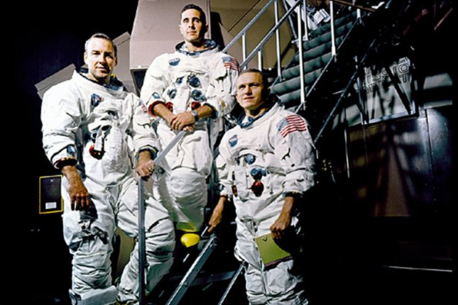 The Apollo 8 crew, (L to R) James A. Lovell Jr., William A. Anders, and Frank Borman are photographed on a Kennedy Space Center simulator in their space suits in Florida on November 22, 1968. Apollo 8 was the first manned mission to the moon and entered lunar orbit 40 years ago on Christmas Eve, December 24, 1968. NASA/UPI