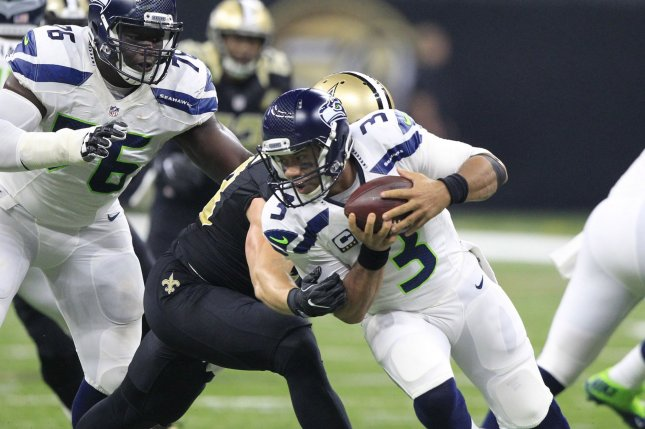 Seattle Seahawks quarterback Russell Wilson (3) is sacked for 11 yards by New Orleans Saints defensive end Paul Kruger (99) in the first quarter at the Mercedes-Benz Superdome in New Orleans October 30, 2016. File photo by AJ Sisco/UPI