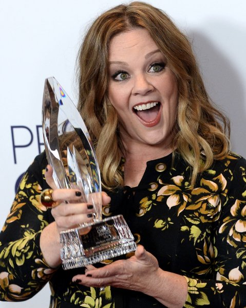 Melissa McCarthy appears backstage with her award for Favorite Comedic Movie Actress during the 43rd annual People's Choice Awards on January 18. The actress channels White House Press Secretary Sean Spicer in new SNL promo. File Photo by Jim Ruymen/UPI