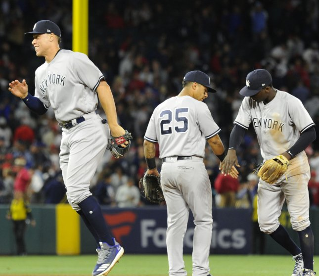 New York Yankees' Aaron Judge, Gleyber Torres, and Didi Gregorius celebrate after beating the Los Angeles Angels In April. The Yankees face the Tampa Bay Rays on Thursday. Photo by Lori Shepler/UPI
