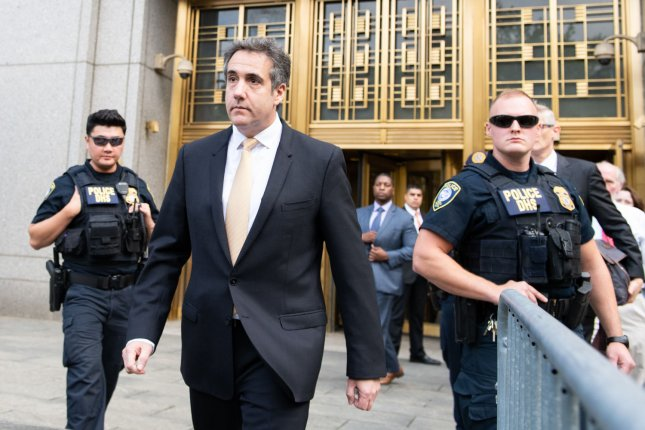 Federal prosecutors granted American Media Inc. CEO David Pecker immunity in the investigation into hush-money payments to two women by President Donald Trump's former personal attorney Michael Cohen, seen here after pleading guilty to campaign finance fraud and tax evasion on Tuesday. Photo by Corey Sipkin/UPI