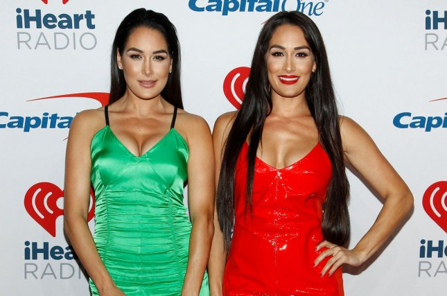 Nikki Bella (R) with her twin sister Brie Bella. Nikki says she doesn't want another public relationship following her breakup with John Cena. File Photo by James Atoa/UPI