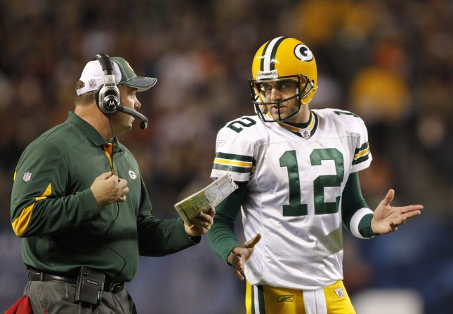 Green Bay Packers quarterback Aaron Rodgers (R) talks with head coach Mike McCarthy during a timeout in the first quarter at Soldier Field in Chicago on September 27, 2010. UPI/Brian Kersey