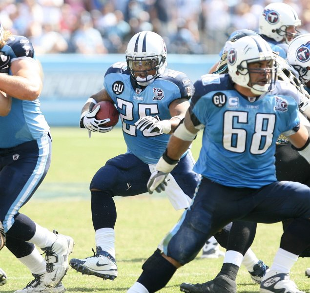 Tennessee Titans running-back LenDale White (25) rushes behind Titans center Kevin Mawae (68) at LP Field in Nashville, Tennessee on September 7, 2008. The Titans defeated the Jaguars 17-10. (UPI Photo/Frederick Breedon IV)