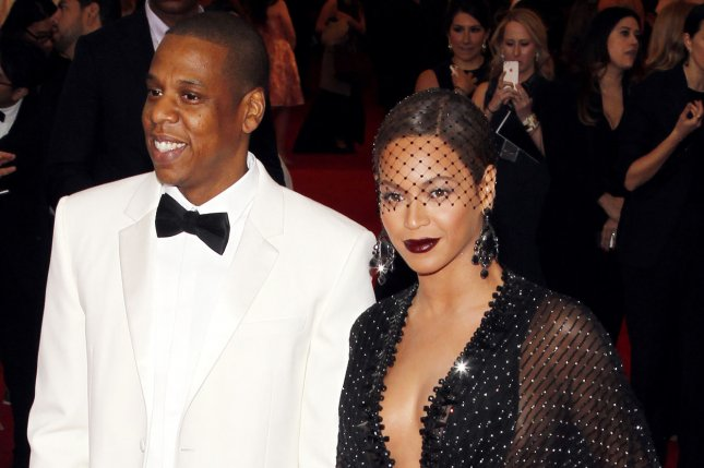 Jay-Z and Beyonce arrive on the red carpet at the Costume Institute Benefit celebrating the opening of Charles James: Beyond Fashion and the new Anna Wintour Costume Center at the Metropolitan Museum of Art in New York City on May 5, 2014. UPI/John Angelillo