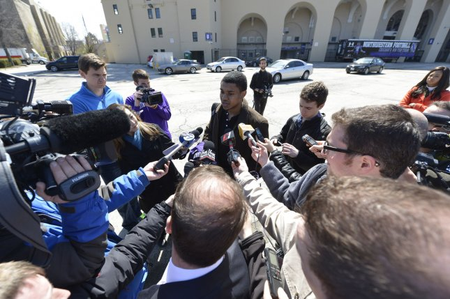 Former Northwestern football player Michael Odom talks to reporters at Northwestern University on April 25, 2014 in Evanston, Illinois. The players are voting Friday on whether to form the nation's first union for college athletes, a decision that has far reaching implications for amateur sports. As a former player, Odom did not vote. UPI/Brian Kersey
