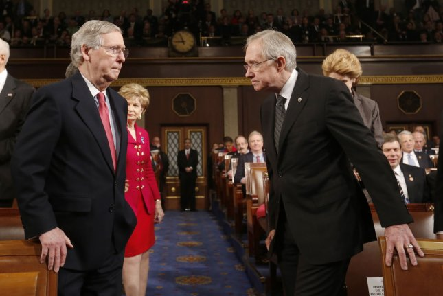 Senate Minority Leader Mitch McConnell and Senate Majority Leader Harry Reid. UPI/Larry Downing/Pool