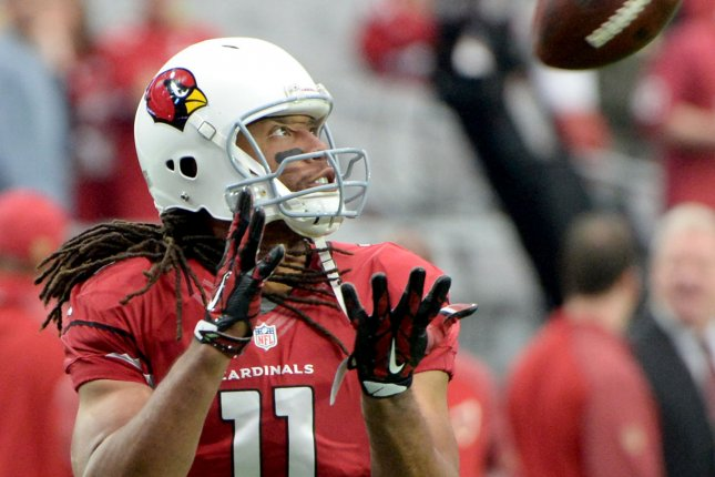 Arizona Cardinals receiver Larry Brown catches a pass as he warms up before the Cardinals-Seattle Seahawks game at University of Phoenix Stadium in Glendale Arizona, January 3, 2016. Photo by Art Foxall/UPI