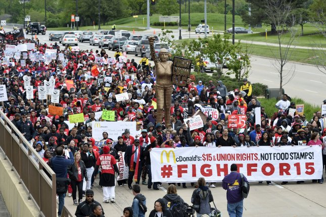 Organized labor holds a Fight for $15 rally outside McDonald's headquarters in Oak Brook, Ill., in 2015. While the issue remains unresolved on the federal level, 20 states and the District of Columbia are slated to increase their minimum wages in 2017. File Photo by Brian Kersey/UPI
