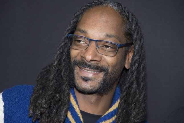 Snoop Dogg attends the premiere of the film Meet the Blacks on March 29. The rapper was approached by a man looking for a fight during the funeral of actor Ricky Harris. File Photo by Phil McCarten/UPI