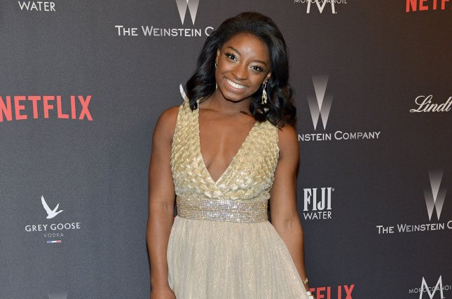 Olympic gold medalist gymnast Simone Biles arrives at the Weinstein Company and Netflix 2017 Golden Globes after party in Beverly Hills on January 8. Biles was eliminated in Monday's Dancing with the Stars semifinals. File Photo by Christine Chew/UPI