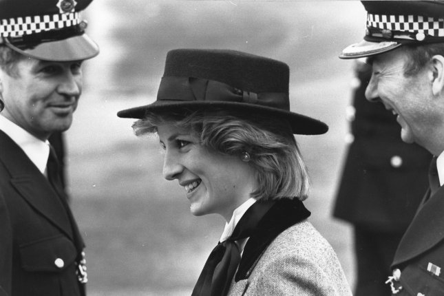 The Princess of Wales on March 29, 1984, walks past two police officers during her visit to the Metropolitan Police Training Establishment in Hendon, England. UPI File Photo