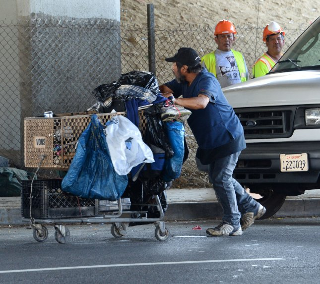 A homeless encampment under the Hollywood Freeway is dismantled in Los Angeles on August 23, 2015. According to a U.N. report released this month, there were 6,696 arrests of homeless persons between 2011 and 2016 in the city's Skid Row section. File Photo by Jim Ruymen/UPI