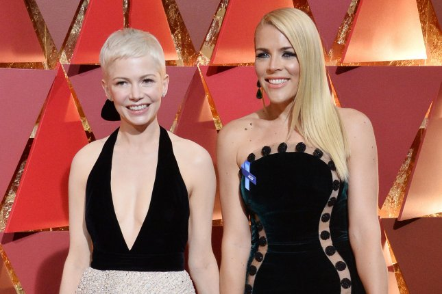 Busy Philipps (R), pictured with Michelle Williams, supported the actress on the 10-year anniversary of Heath Ledger's death. File Photo by Jim Ruymen/UPI