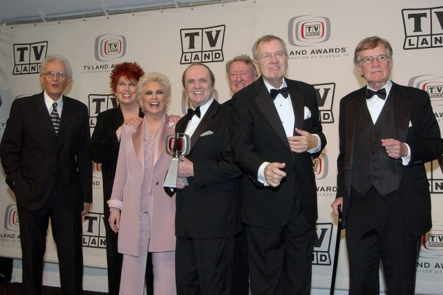 Cast members from The Bob Newhart Show and Newhart -- Peter Bonerz, Marcia Wallace, Suzanne Pleshette, Bob Newhart, Tom Poston, Bill Daily and Jack Riley -- appear backstage at the TV Land Awards on March 13, 2005. Daily died this week at the age of 91. File Photo by John Hayes/UPI