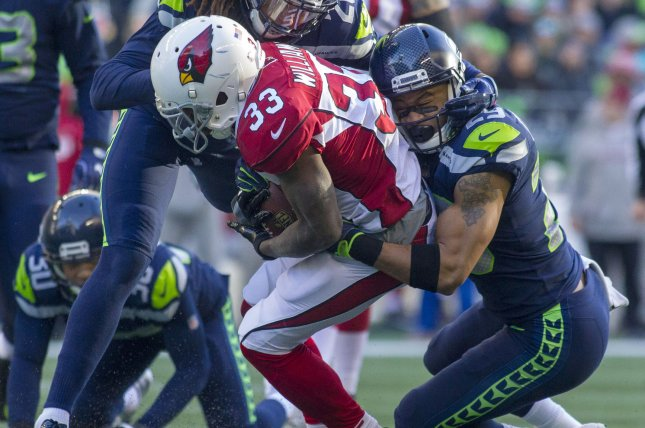 Former Arizona Cardinals running back Kerwynn Williams (33) is tackled by Seattle Seahawks free safety Earl Thomas (29) after a gain of four yards during the second quarter on December 31, 2017 at CenturyLink Field in Seattle, Washington. Photo by Jim Bryant/UPI