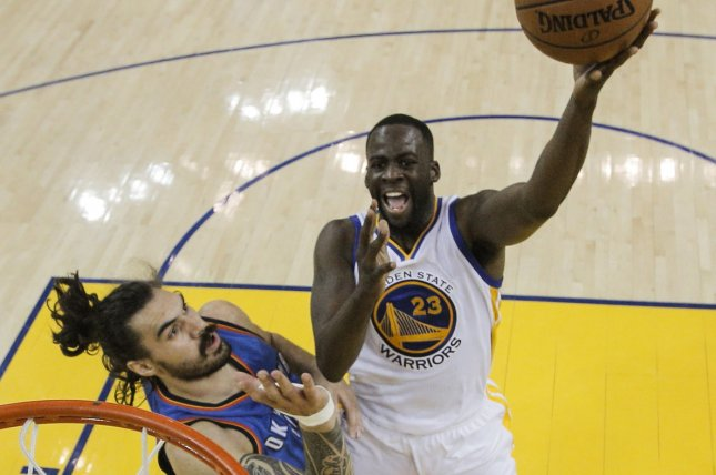 Golden State Warriors forward Draymond Green shoots over Oklahoma City Thunder center Steven Adams on May 26, 2016 at Oracle Arena in Oakland, California. Pool photo by Carlos Avila Gonzalez/UPI