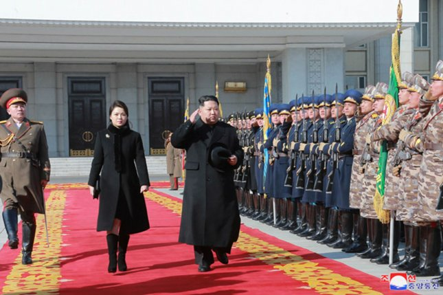 Kim Jong Un (C) presided over a general meeting of lower-ranking North Korea military officers for the first time since 2013, state media reported. File Photo by KCNA/UPI