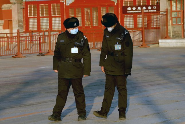 Police wear protective masks as the patrol around the Forbidden City, which remains closed due to the coronavirus alert, in Beijing on Wednesday. Photo by Stephen Shaver/UPI
